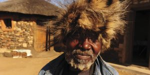 A traditional healer wearing a fur hat.