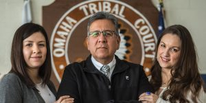 Ed Zendejas, the chief judge on the Omaha Reservation, stands flanked by his daughters Brooktynn Zendejas Blood (left) and Jordan Zendejas, also judges.