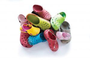 A pile of Croc shoes.