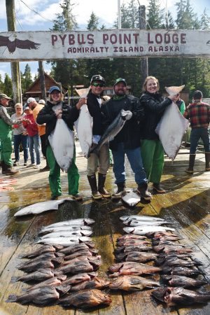 BYU students and their boat captain (second from right) show off their catch.