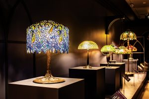photo of Tiffany Studios' Wisteria Library Lamp at BYU MOA exhibition