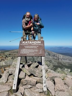 A couple poses on the summit on the Appalachian Trail.