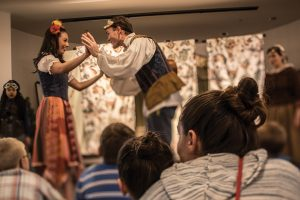 A young woman and young man portray the parts of Romeo and Julieta in the bilingual play.