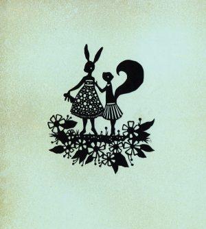 A papercut art piece depicting a rabbit and squirrel
