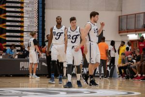 Jimmer Fredette and Brandon Davies on the basketball court of during the 2018 The Basketball Tournament