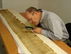 BYU professor Donald Parry pores over ancient scrolls.
