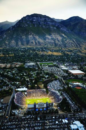 An aerial shot of LaVell Edwards Stadium with Y Mountain in the background.