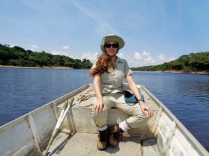 Reptile and amphibian researcher Fernanda Werneck on a boat in the Amazon.