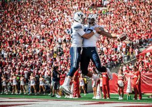 BYU football players Tanner Mangum and Moroni Laulu-Pututau celebrate following a touchdown at at football game at Wisconsin in September 2018.