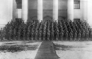 Dozens of soldiers stand on the steps of the Maeser Building at BYU during World War I