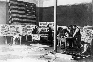 Students at BYU during World War I make posters to raise funds for the war.