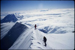 Stacy Taniguchi and another climber are pictured on the ridge line of Denali.