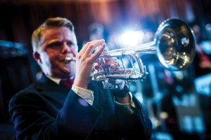 A close-up of a jazz trumpet player
