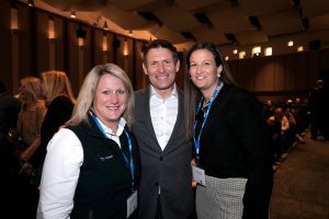 Steve Young stands in between Amy Wilson and Liz Darger at a BYU-hosted NCAA Common Ground event.
