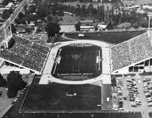 A black-and-white aerial picture of a packed Cougar Stadium during a football game in 1964.
