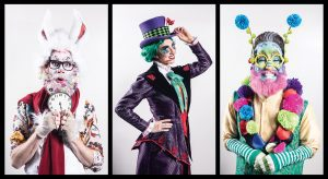 Three theater students, playing the White Rabbit, the Mad Hatter, and the Caterpillar, in costume for Wonderland.
