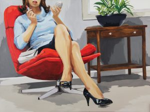 A woman in high heels and a skirt, whose eyes are out of the photo frame, reclines in a red chair and puts on lipstick with one hand. She is looking into a small cosmetic mirror in her other hand.