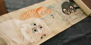 The ghost scroll is rolled open to the image of the Japanese nurikabe