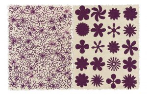 Print of purple flowers. The left half of the flowers are close together and smaller and the right half are larger and spread out evenly in rows.