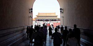 People walk through a tunnel in Beijing's Forbidden City.