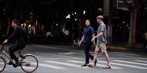 BYU students Danny Dawson and Nathan Jensen walk down a street in Shanghai, China.