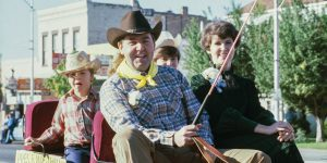 President Jeffrey R. Holland and his family ride in a wagon during the 1980 Homecoming parade.