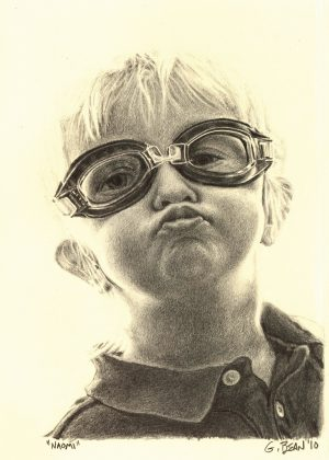 Greg Bean draws with graphite, a picture of a child wearing goggles and making a kissy face.