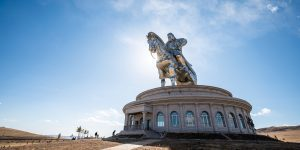 A round building with a 250-ton stainless steel statue of Genghis Khan on a horse.