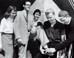 An archival photo from 1958 of BYU freshmen shining shoes.