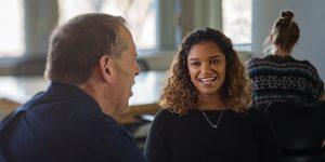 BYU student Kylee Shepherd meets with her freshman mentor, Ed Adams.