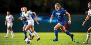 BYU forward Elise Flake dribbles the ball.