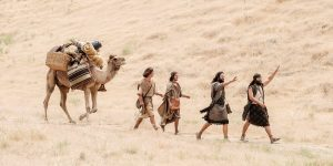 A photo from the filming of the Book of Mormon Videos shows Nephi's family walking across the landscape with a camel in tow.