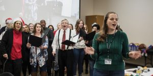 BYU grad student Amelia Jackson leads the Utah Valley Aphasia Choir singing a song.