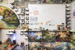 A corner of James Gaskin's office with 3D printed temples, Disney puzzles, and other knick knacks.