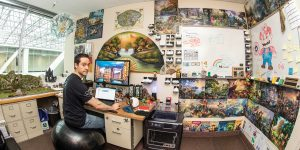 BYU information systems professor James Gaskin in his office in the Tanner Building. The walls and the office are covered in Disney puzzles, 3D printed temples, trinkets, and minerals/gems.