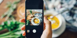 A phone taking a picture of a meal.