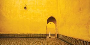 A yellow Arabian-style doorway in a mosque in Morocco.