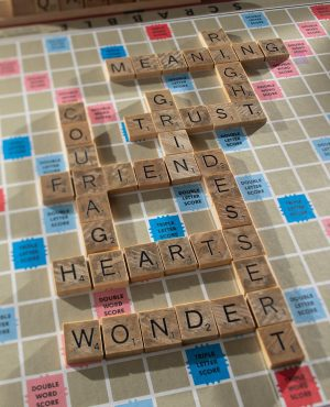 A Scrabble puzzle with words like courage, wonder, and dessert.