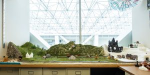 A diorama in James Gaskin's office featuring Y Mountain, Hogwarts, a hot air balloon, and a train.