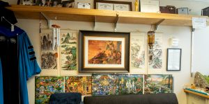 Part of James Gaskin's office with puzzles and paintings on the wall.