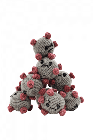 Stuffed virus toys with varying upset faces built into a pyramid tower.