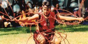 Joseph P. K. Ahuna III (BA '03, JD '08, MPA '08) performs a Native American hoop dance at a multicultural festival in Hawaii.