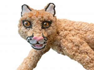 A cougar that has been made from rice crispy treats.