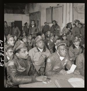A sepia photo of a gathering of the Tuskegee Airmen.