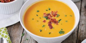 Chipotle butternut squash soup in a bowl.
