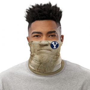 A photo illustration shows a man wearing a neck gaiter style mask with the nose, mouth, and busy beard of Brigham Young.