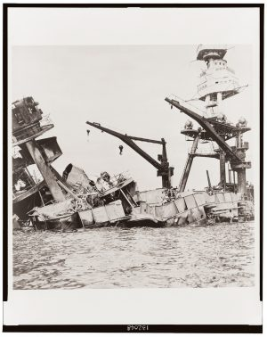 A sepia photo from 1941 shows the wreckage of the USS Arizona ship after the Attack on Pearl Harbor.