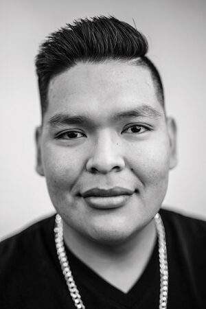 A black and white photo of a Native American, male BYU student.