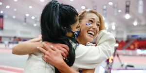 BYU track coach Diljeet Taylor hugs Courtney Wayment after winning a race at the NCAA indoor track championships.
